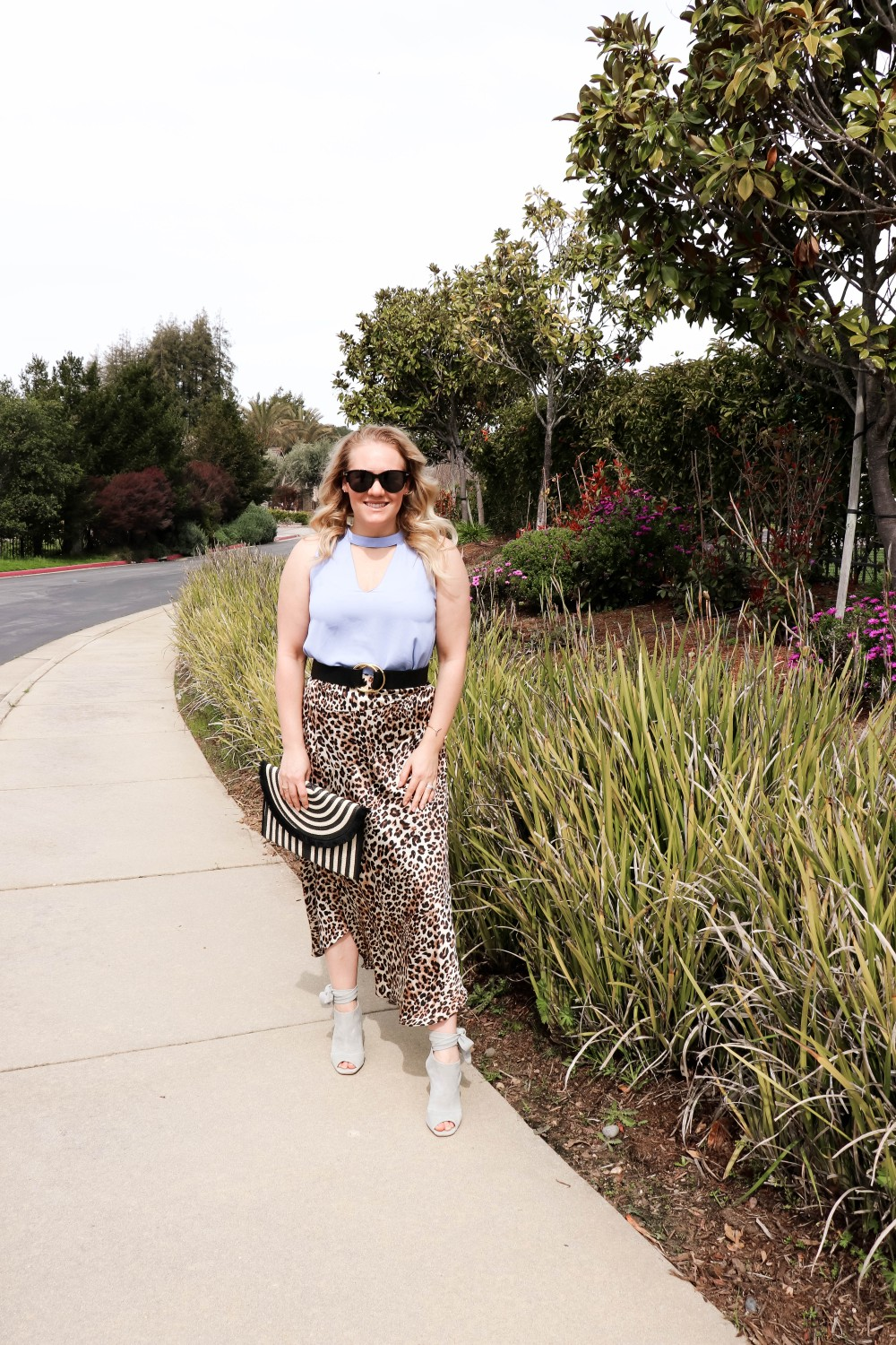 Sharing this perfect for Spring look and showing you how to style leopard print for spring on Have Need Want! Click on the photo to check out the post + get outfit details and similar options you can shop now! #outfitinspiration #springstyle #leopardprintskirt #stylingtips #springfashion #fashiontrends