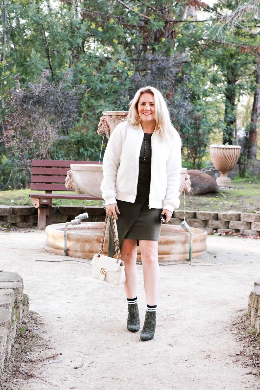 Varsity Style Wearing Fuzzy Bomber Jacket and Stripe Sock Booties | Have Need Want #varsitystyle #bomberjacket #sockbooties #casualstyle #stuartweitzman