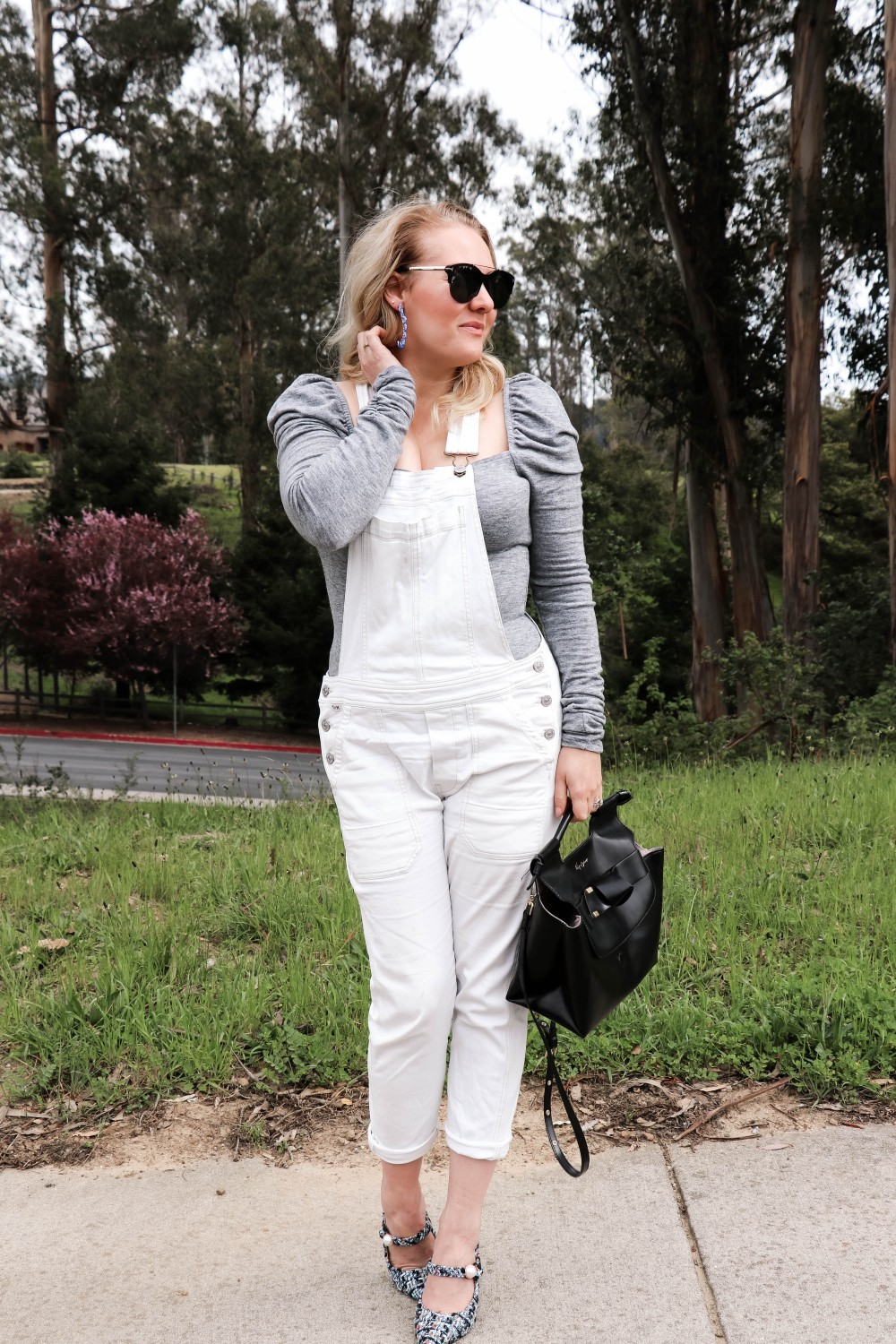 White overalls for Spring on Have Need Want! Plus sharing some of my favorite puff sleeve tops you can wear year round. Click on the photo to read the post! #overalls #springstyle #whiteoveralls #outfitinspiration #bloggerstyle #momstyle
