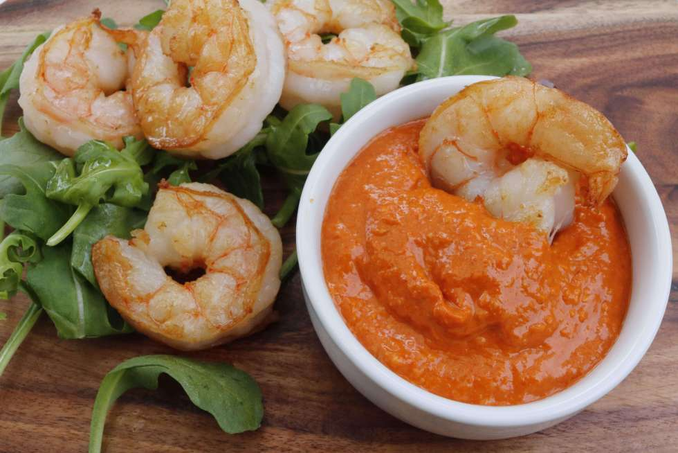Romesco sauce is a delicious red pepper & nut sauce that originated in Spain. At 1 net carb per serve it's a wonderful low carb option to add to your meal.