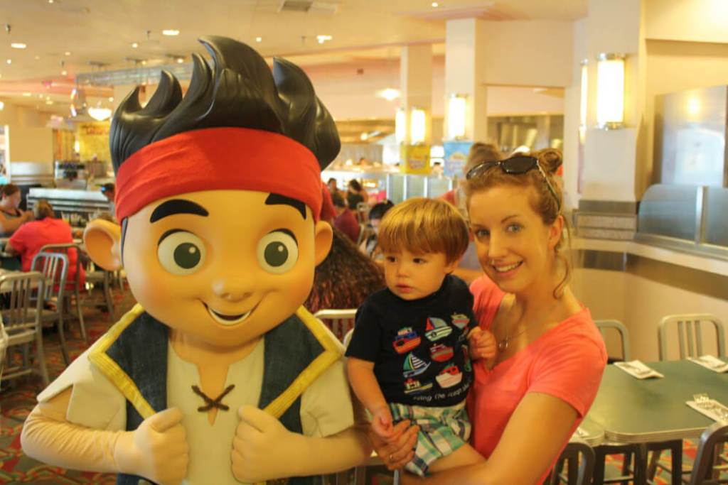 Characters greetings with a toddler at Walt Disney World