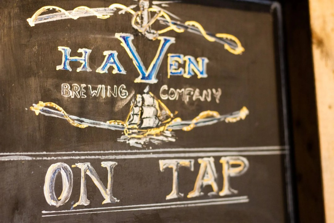 """Photo of chalk board with writing """"Haven Brewing Company; On Tap"""""""