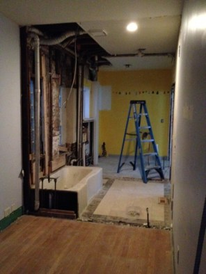 Under construction progress ~ demo of existing bath and laundry room {vie from old spare bedroom into old bath and laundry}
