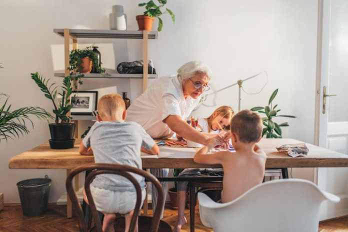 Grandma and grandchildren play and paint at home