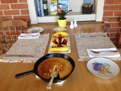 Cast iron pan cornbread with fruit start the morning!