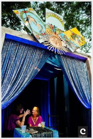 Tarot card reading is just one way to have your fortune told at Into the Mystic New Age & Psychic Fair, going on today in Havenwood Falls Town Square Park.