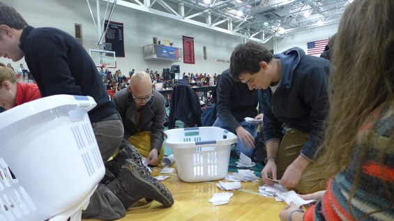 Students' Council members counting paper ballots, collected in laundry baskets, for an amendment.