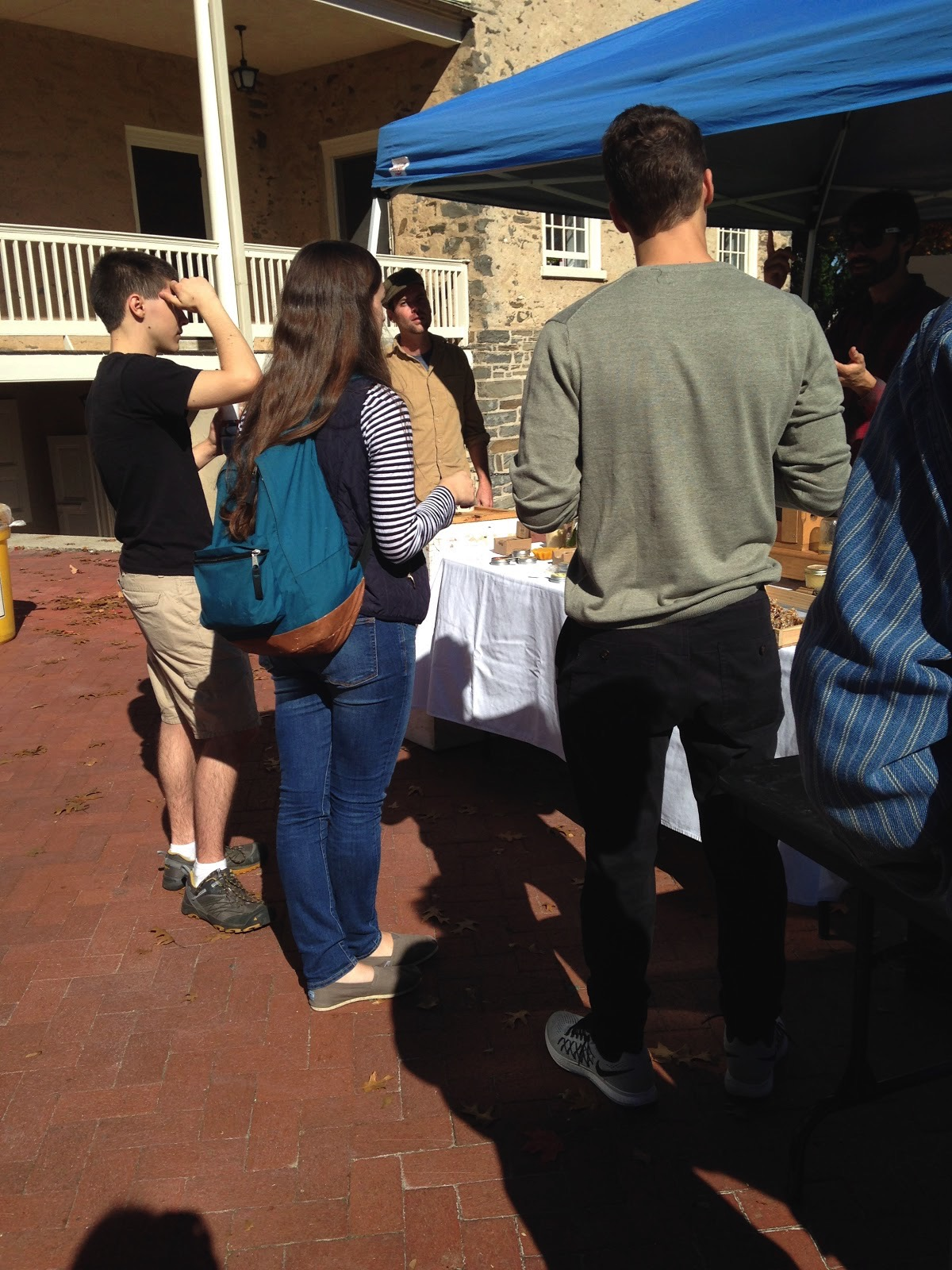 Students gathered around the Bee Boys table.