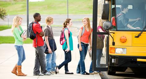 teens boarding a schools bus