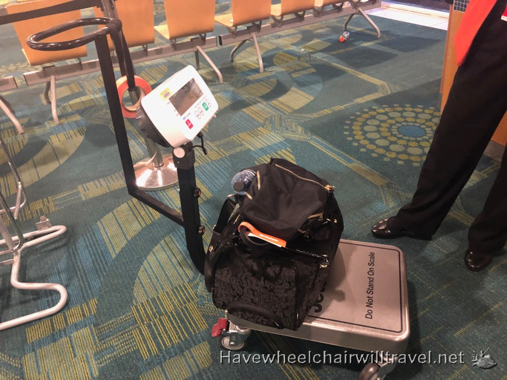 Jetstar budget airline review - weighing luggage - Have Wheelchair Will Travel