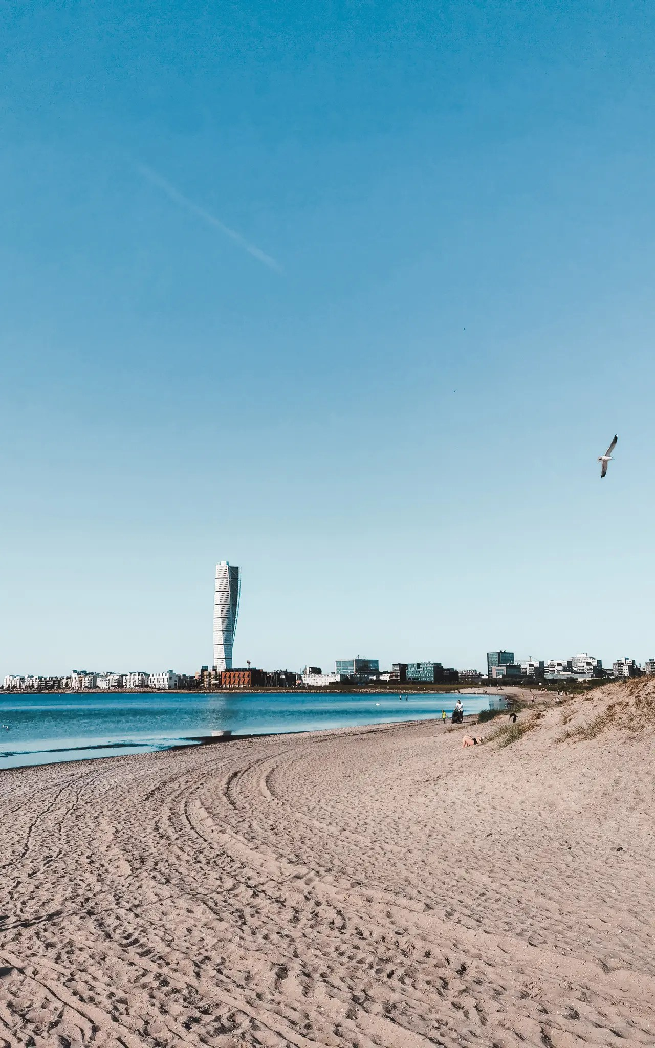 Malmö's Ribersborg beach with the view of the Turning Torso, the tallest building in Scandinavia.