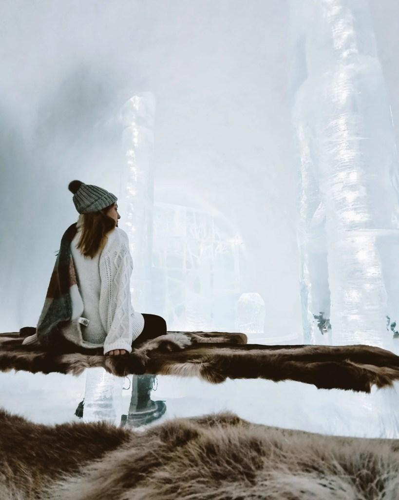 Woman sitting in the ice hotel in Jukkasjärvi, Swedish Lapland.