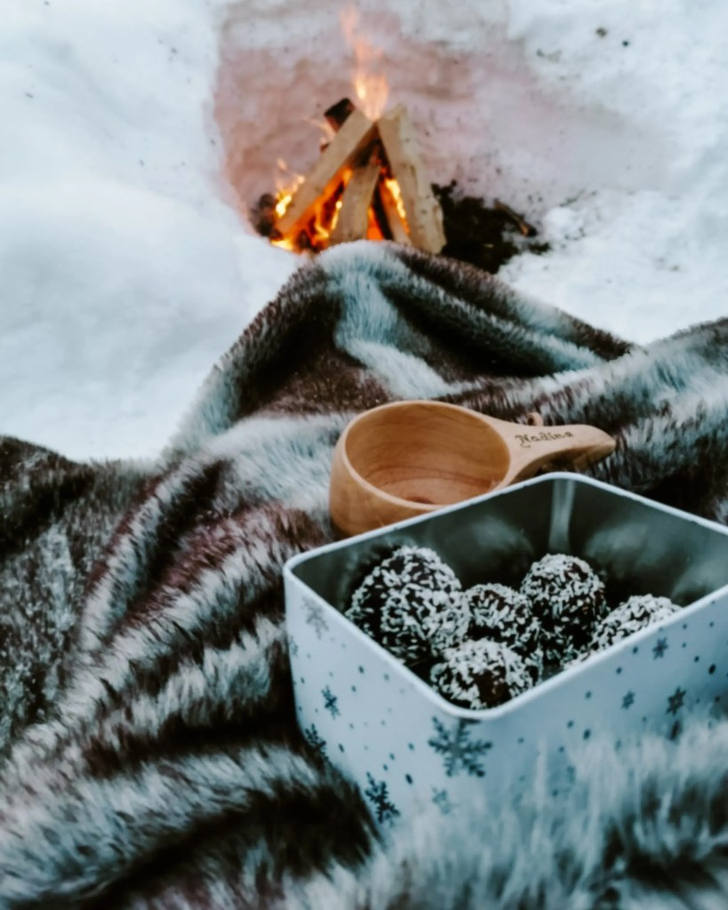 Fika by the fire during a Sweden winter holiday.