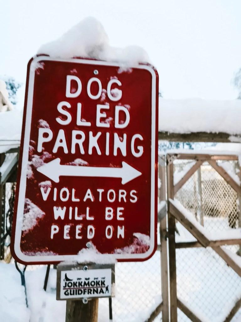 Funny sign at a dog sledding tour company in Jokkmokk, Swedish Lapland.