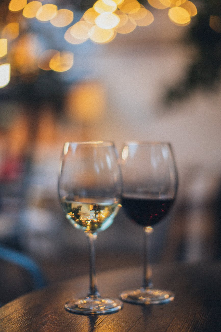 shallow focus photo of two wine glass
