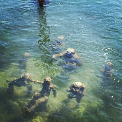 """""""The Merman and 7 Sons"""" underwater statues"""