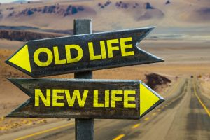 Old Life - New Life signpost in a desert road on background