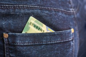International student identity card in a back pocket of jeans