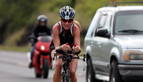 Triathlete Shanna Armstrong is the lead female as she bikes along the Keaau Bypass (Hwy 130) headed towards Hilo during the second day of the Ultraman Triathlon.
