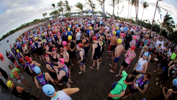 Swimmers get last minute instructions before the start of the 14th Annual Lavaman Triathlon at Anaehoomalu Bay in Waikoloa. Photography by Baron Sekiya   Hawaii 24/7