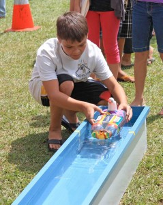 A student prepares to launch his solar boat in the regatta. Photo courtesy of HELCO