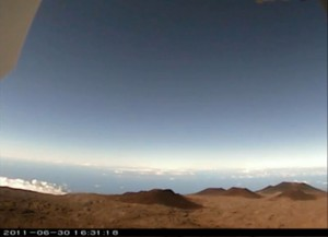 A daytime reference view through the NNW webcam of Canada-France-Hawaii Telescope. This is the view in the opening sequence of the video at the top of this post. Photo courtesy of CFHT.