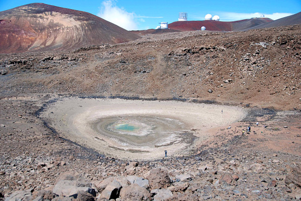 USGS Photo, looking north, at what remained of Lake Waiau on September 26, 2013. The water area was just 15 meters (yards) wide at this time. Prior to 2010, the lake occupied the entirety of the now-dry lake bed, which is about 100 meters (yards) wide. The astronomical telescopes at the summit off Mauna Kea are visible on the skyline.