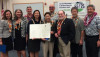 """The launch of phase II of the """"55 by '25"""" campaign is celebrated by (L to R): Senator Jill Tokuda, Dr. GG Weisenfeld, David Lassner, Karen Lee, Kathryn Matayoshi, John La Forgia, Gov. Neil Abercrombie, Rep. Roy Takumi, and John Komeiji. (Photo courtesy of Department of Education)"""