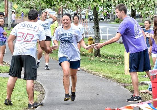 Students complete a rigorous 6-mile bike course around the Keaau campus. (Photo courtesy of Kamehameha Schools)