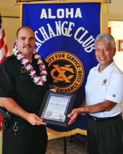 Hilo Exchange Club President Andy Iwashita presents an 'Officer of the Month' award to Officer Brian Souki