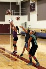 Girls participate in passing drills.