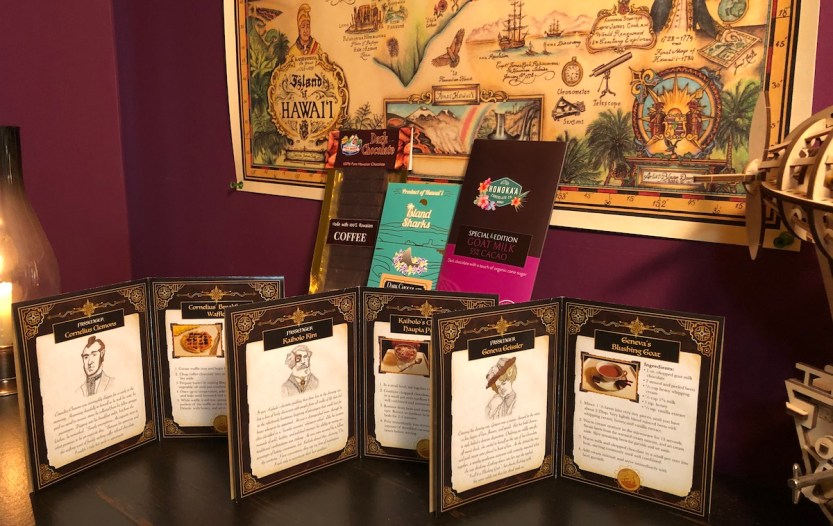 Hawaii Cacao Express, Chocolate Trunk, May 2021, characters and recipes on three booklets