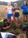 Alli Webster digs a 50 cm deep hole in the ground while Abby Kelley embraces her love of dirt.