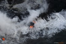 Molten lava pours into the sea at the Kamokuna ocean entry within the Hawaii Volcanoes National Park, quickly forming a new delta over the one that just collapsed last week.
