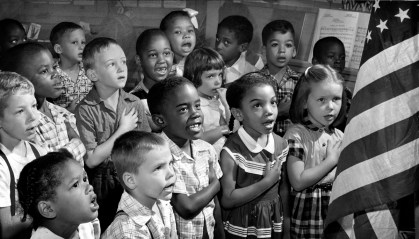 6/26/55 -BALTIMORE, MD. 1st grade at Public School 60, say the pledge of allegiance to the flag. Richard Stacks/Baltimore Sun