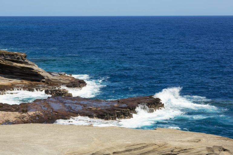 Tips for Hawaii Island Hopping featured by top Hawaii blog, Hawaii Travel with Kids: Waves breaking on the cliffs near Lanai Lookout. | island hopping hawaii