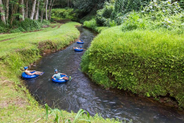Kids will love doing sugar cane canal tubing on Kauai. The Best Kauai beaches and activities for families featured by top Hawaii travel blog, Hawaii Travel with Kids
