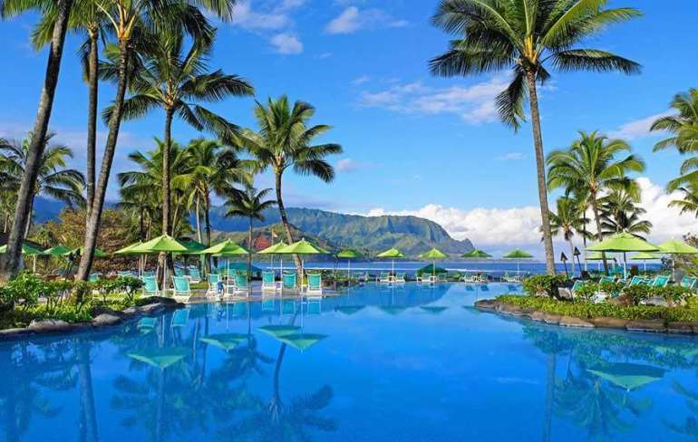 The Best Kauai Beaches for families featured by top US travel blog, Hawaii Travel with Kids: The St. Regis Hotel on Kauai is one of the best Kauai hotels on the North Shore