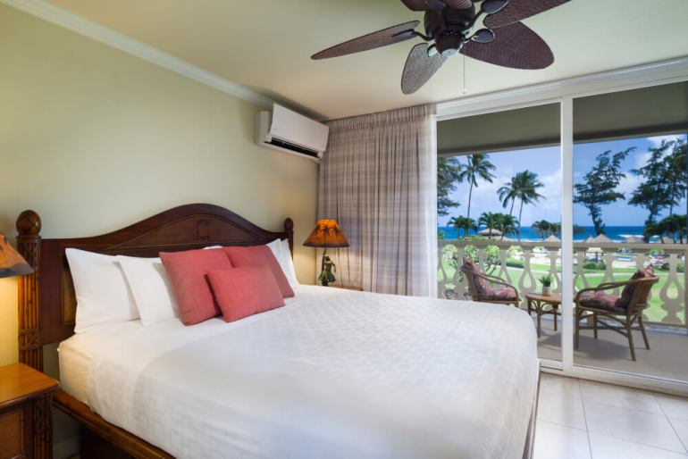 Hawaii on a Budget: Top 10 Cheap Places to Stay in Kauai, featured by top Hawaii travel blog, Hawaii Travel with Kids: The Aston Islander on the Beach is a budget-friendly hotel on Kauai