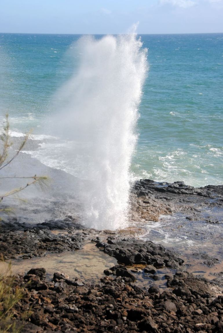 Top 25 Things to do in Poipu, Kauai featured by top Hawaii blog, Hawaii Travel with Kids: Spouting Horn in Poipu is an awesome free thing to do on Kauai with kids