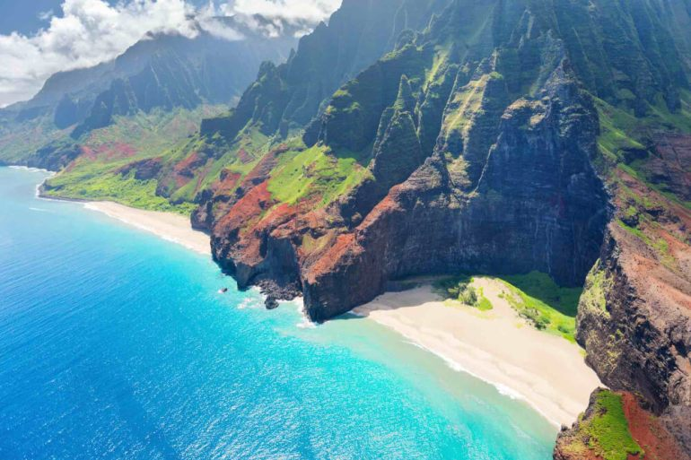 One tip when you plan a trip to Kauai is that the highway doesn't go all the way around because the Na Pali Coast is in the way. Image of the Na Pali Coast on Kauai.