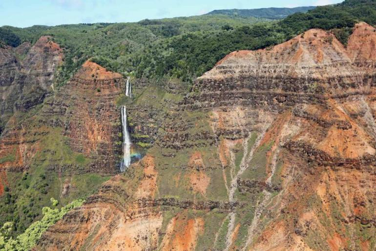 Oahu or Kauai: Which is the Best Hawaiian Island for Kids? Tips featured by top Hawaii travel blog, Hawaii Travel with Kids: You can hike ot see Waipoo Falls in Waimea Canyon or you can see it from the lookout.