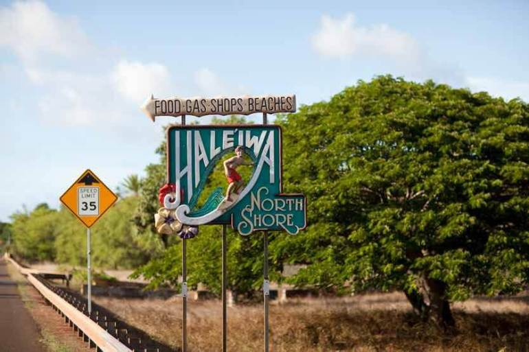 The best things to do in North Shore Oahu featured by top Hawaii blog, Hawaii Travel with Kids: Nothing is more iconic that this Haleiwa sign as you enter North Shore Oahu