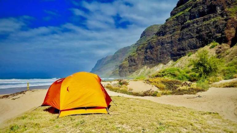 Guide to Camping in Hawaii featured by top Hawaii blog, Hawaii Travel with Kids. | Camping in Hawaii can be really cheap, if you know where to stay, like at the Na Pali Coast on Kauai