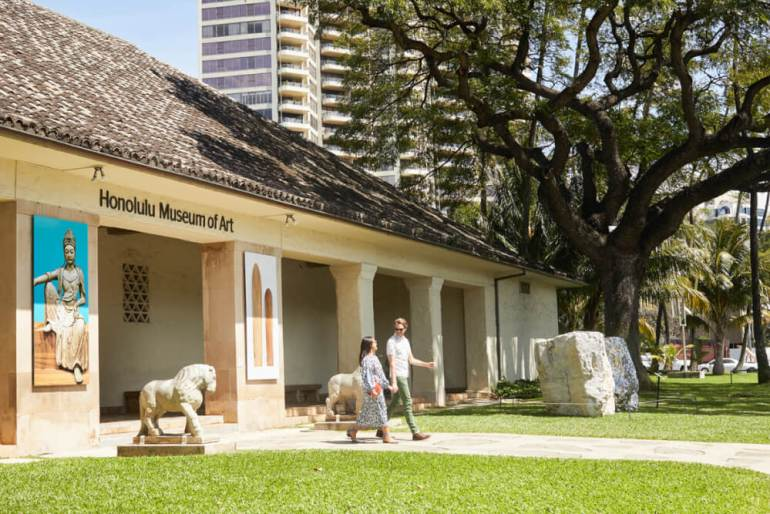 Things to Do in Hawaii with Kids: a review of Honolulu Museum of Art on Oahu featured by top Hawaii blog, Hawaii Travel with Kids: image of Couple walking out the entrance to the Honolulu Museum of Art on Oahu