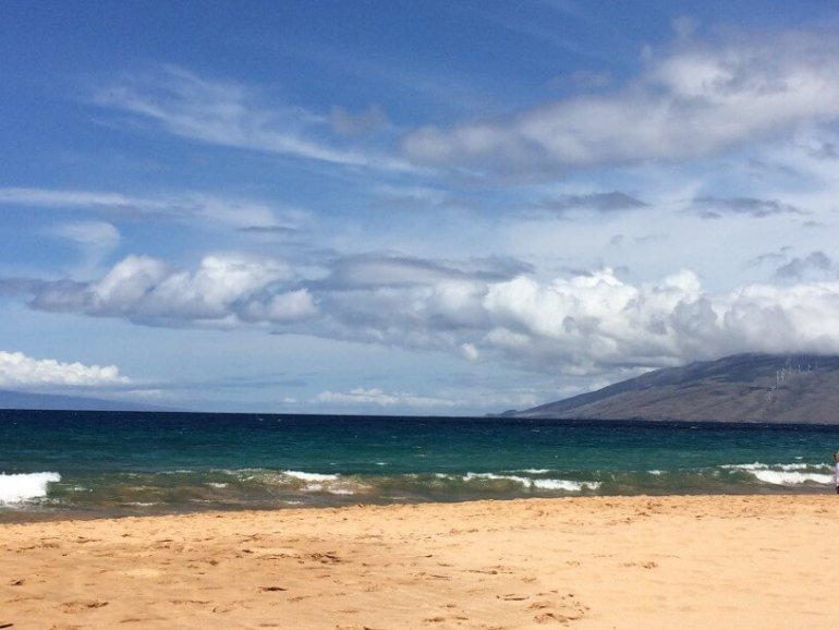 Where to See Turtles in Maui, tips featured by top Hawaii blog, Hawaii Travel with Kids: image of Keawakapu Beach on Maui