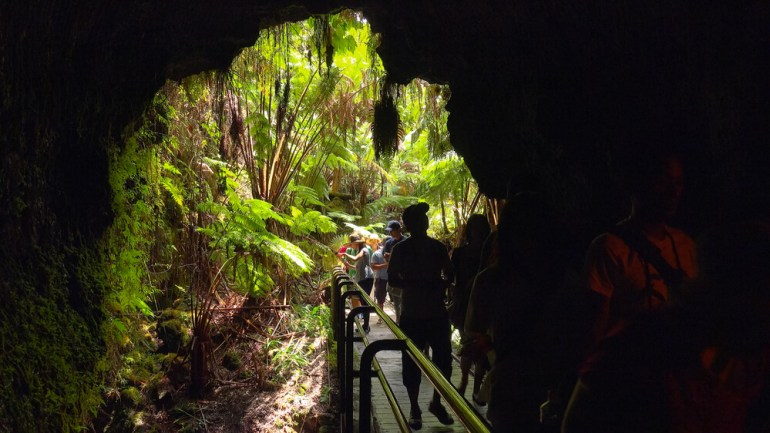 The Ultimate Guide to Hawaii Volcanoes National Park featured by top Hawaii blog, Hawaii Travel with Kids: Tourists entering the Thurston Lava Tube in Hawaii Volcanoes National Park
