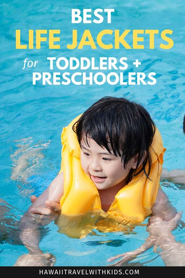 Find out the best life jackets for toddlers and preschoolers by top Hawaii blog Hawaii Travel with Kids. Image of a toddler swimming with a life jacket in a pool.