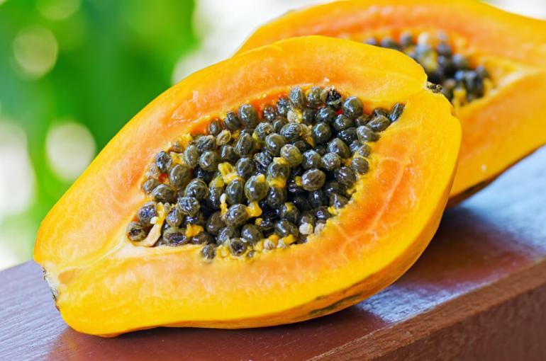 15 Hawaiian Fruits to Try featured by top Hawaii blog, Hawaii Travel with Kids: Hawaiian papapya fruit