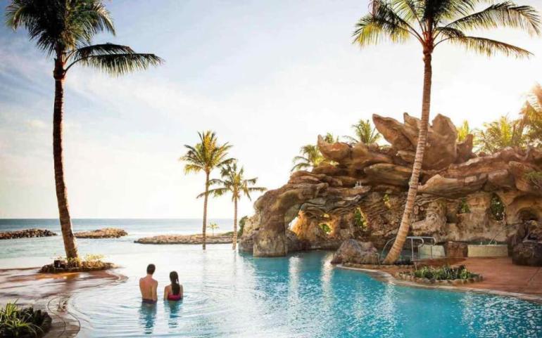 Top 8 Romantic Oahu Honeymoon Resorts featured by top Hawaii blog, Hawaii Travel with Kids: Aulani Resort swimming pool